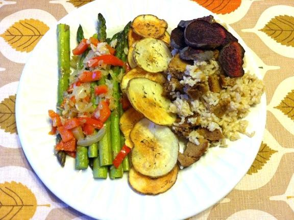 Asparagus with peppers, onions, and garlic. Baked potato slices with thyme and salt. Brown rice with field roast holiday roast and some beets.