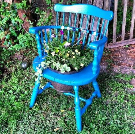 Old chair? Blue spray paint and a hole for a plant..LOVE THIS!