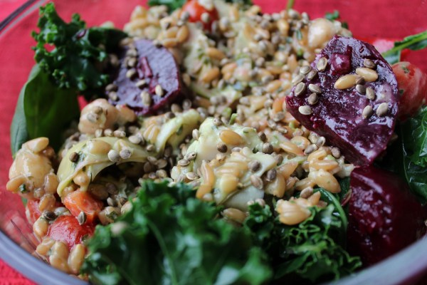 Lunch is always in a bowl. Spinach, kale, farro, wheat berries, beets, red pepper, and hemp seeds.
