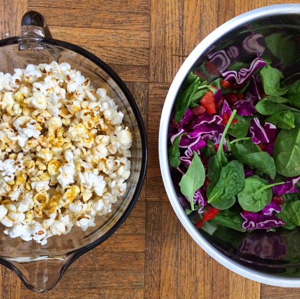 Staple meal. Everyday. Popcorn and salads in bowls fit for sasquatch.